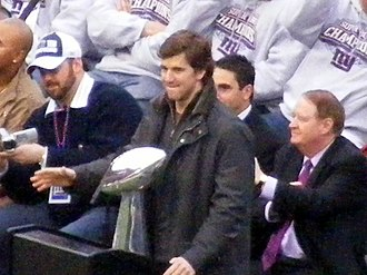 Eli Manning - Manning with the Lombardi Trophy during the Giants Super Bowl victory rally at Giants Stadium.
