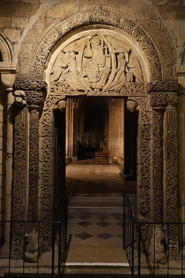 The Prior's Door in the south wall of the nave. The tympanum carving is thought to date from 1135. Ely Cathedral Prior's Door.jpg