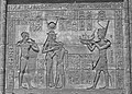 Emperor Trajan depicted as a Pharaoh offering a Votive Boat to the Goddess Hathor ... (36518347842).jpg
