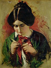young woman holding a knitting needle, intently looking at a piece of cloth in her hands
