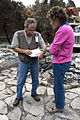 FEMA - 33541 - A resident speaks with a FEMA inspector in California.jpg