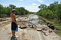 FEMA - 35795 - Resident looks at a damaged road in Iowa.jpg