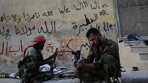 2012–13 escalation of the Syrian Civil War - Free Syrian Army fighters clean their weapons during the Battle of Aleppo.