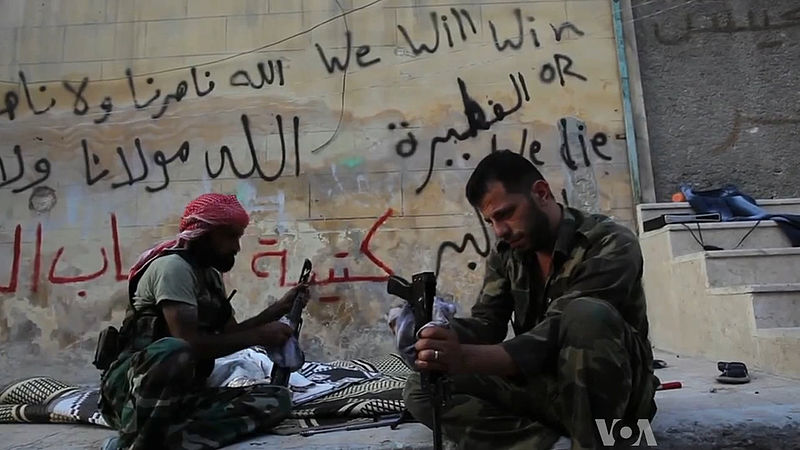FSA rebels cleaning their AK47s in Aleppo, Syria.