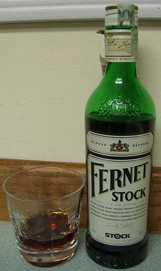 Fernet Stock - A bottle and glass of Fernet Stock