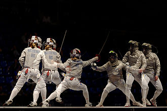 Sabre (fencing) - Olena Voronina scores a hit off Yekaterina Dyachenko (L) in the women's team sabre final of the 2013 World Fencing Championships