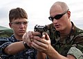 Flickr - Official U.S. Navy Imagery - Sailor shows Sea Cadet proper weapons handling.jpg