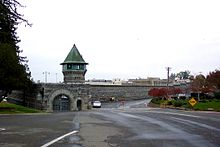 Photo of walls and guard towers of a prison.