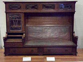 Frederick Meyer - A bookcase settle designed by Frederick Meyer, on display at the DeYoung Museum in San Francisco