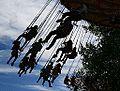 Free people swinging silhouette on amusement park ride creative commons (3107088883).jpg