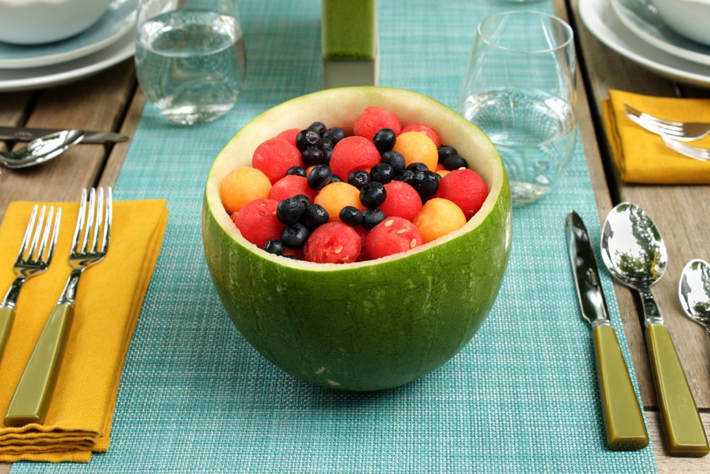 Fruit salad flanked by Sabre flatware.jpg