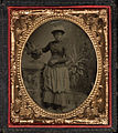Full length portrait, young lady standing against pedestal, with fancy hat. Cased tintype, sixth plate.jpg