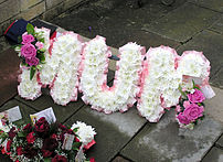 A floral name tribute (spelling out the word