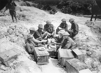John Gellibrand - Gellibrand (wearing a hat) and his staff having breakfast in a shell hole in Sausage Valley.