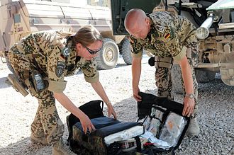 Army Medical Service (Germany) - A German female major and army doctor serving in the ISAF force in Afghanistan, wearing camouflage uniform