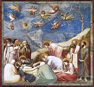 Square fresco. In a shallow space like a stage set, lifelike figures gather around the dead body of Jesus. All are mourning. Mary Magdalene weeps over his feet. A male disciple throws out his arms in despair. Joseph of Arimethea holds the shroud; in Heaven, small angels are shrieking and tearing their hair.