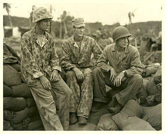 Battle of Guam (1944) - Three Marine officers of an amphibian tractor battalion who took part in the invasion of Guam (left to right): Major Erwin F. Wann, Major W. W. Butler, and Lt. Colonel Sylvester Stephens