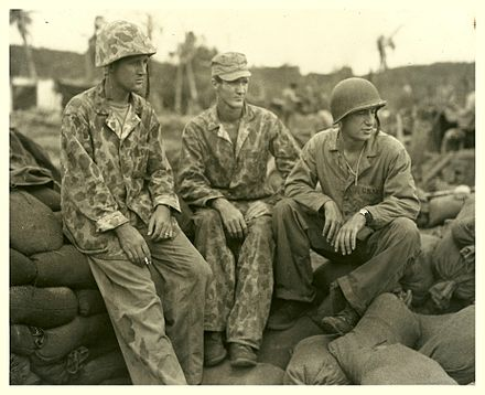 Three Marine officers of an amphibian tractor battalion who took part in the invasion of Guam (left to right): Major Erwin F. Wann, Major W. W. Butler, and Lt. Colonel Sylvester Stephens