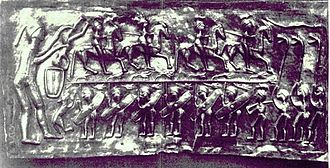 Carnyx - Three carnyx players are depicted at right on plate E of the Gundestrup cauldron.
