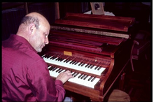 Hans Adler performing on his modern Pleyel harpsichord