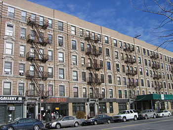 These buildings on West 135 Street were among ...