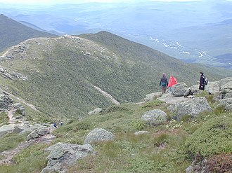 Alpine tundra - Hikers traversing the Franconia Ridge in the White Mountains of New Hampshire, much of which is in the alpine zone.