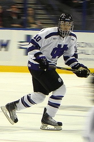 Holy Cross Crusaders men's ice hockey - Holy Cross player skates through the neutral zone looking for a pass (2010)