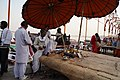 Holy preparations on the banks of the Ganges.jpg