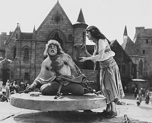 The Hunchback of Notre Dame (1923 film) - Quasimodo being offered water by Esmeralda.
