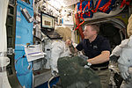 ISS-42 Terry Virts does a checkout of his spacesuit's systems.jpg