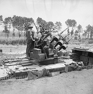 76th Anti-Aircraft Brigade (United Kingdom) - Crusader AA tank mounting a triple 20mm gun in a hull-down position, 19 July 1944