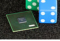 Image of GP5 chip next to a pair of dice for size comparison.jpg