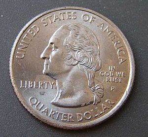 "50 State Quarters - Coin with partially rubbed off ""In God We Trust"" motto"