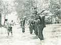 Indonesian Navy Commando Corps in swamps chasing PERMESTA troops, Jalesveva Jayamahe, p154.jpg