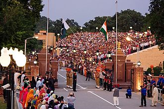 Wagah Border is situated between Amritsar and Lahore, became the main border crossing after partition of Punjab is known for its elaborate ceremony International border at Wagah - evening flag lowering ceremony.jpg