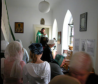 Penance - Russian Orthodox priest hearing confessions before Divine Liturgy