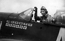 James Howard sitting in the cockpit of his P-51 Mustang fighter plane