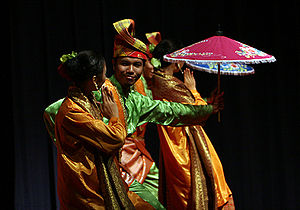 Dancers in traditional Malay costume during a dance