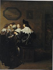 Company with a man playing the lute, seated at a table