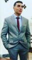Jorge Correia in a suit.png