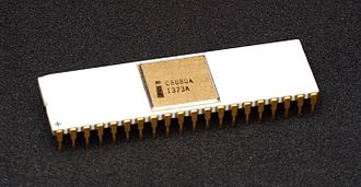 Intel 8080 - An Intel C8080A processor variant with white ceramic, a gold heat spreader, and gold pins.