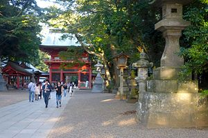 Kashima Shrine - Romon gate and stone lanterns, 2015