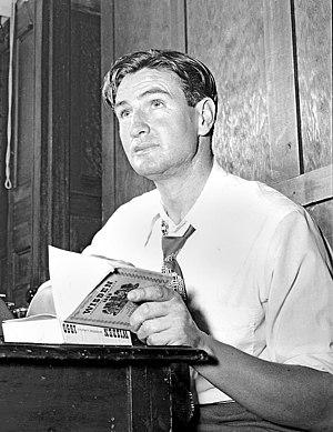 Keith Miller - Miller reading Wisden Cricketers' Almanack in 1951