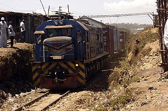 GE U26C - Kenyan 9402 with a goods train