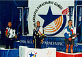 Kingsley Bugarin on podium with minor medallists 100m breast.jpg