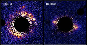 Kuiper belt - Debris discs around the stars HD 139664 and HD 53143 – black circle from camera hides star to display discs.