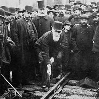 "Sandford Fleming - Sandford Fleming (in tallest hat) at the ceremony of the ""last spike"" being driven on the Canadian Pacific Railway"