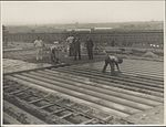 Laying the surface of Harbour Bridge, 1931 (8282711933).jpg