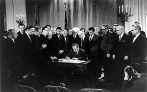 President Johnson signing the Civil Rights Act...