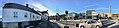 Leirvik, Stord Island, Norway. Hagerupshuset, Sunn Bok, Industriarbeidarmonumentet (Trygve Barstad 1999), Borggarden, town hall (rådhus), parked cars, town square, radio mast tower (antennetårn), etc. Compressed, distorted panorama.jpg